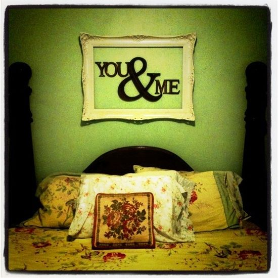 Empty antique style frame with letters, both hung directly on the wall in the bedroom. Shabby chic and a little sexy!