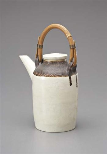 Teapot, Porcelain, white and manganese glazes, sgraffito, bamboo and brass handle. 18 cm. (7 in.) high, c.1955
