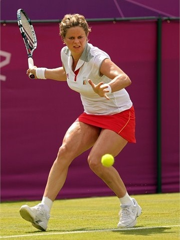 Kim Clijsters of Belgium returns a shot against Roberta Vinci of Italy during her women's Singles Tennis match on Day 1 of the London 2012 Olympic Games at the All England Lawn Tennis and Croquet Club in Wimbledon on 28 July 2012.