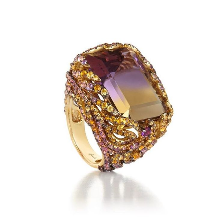Sunny citrine and warm amethysts interweave to create a sinuous, open framed feathered ring that delicately envelopes a 22.13 carat #ametrine at its centre- available on our website now #FineJewellery #annoushkajewellery