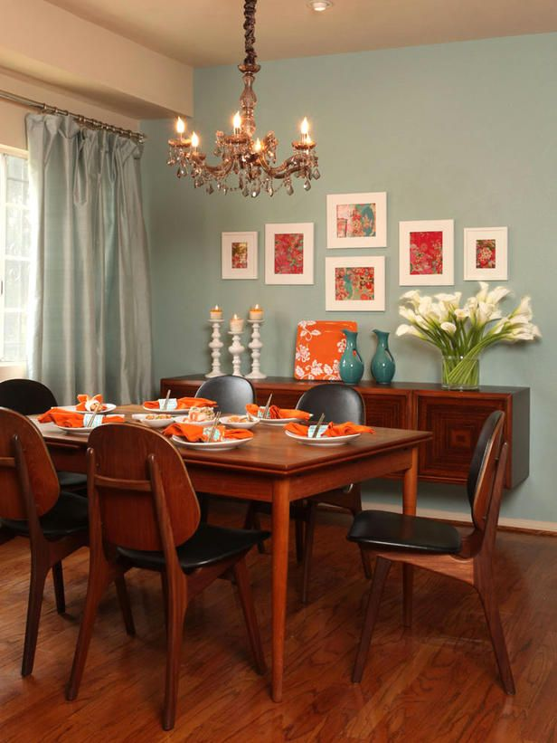HGTV-Modern Flair   Accentuate your table with stylish plate settings to give your dining room a modern edge. For a bolder look, pair blue walls and accents with a vibrant punch of color. In this dining room, spicy tangerine accessories contrast sharply