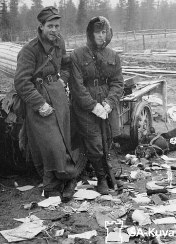two Finnish soldiers enjoying the spoils of Battle from the Lapland War between Finland their former enemy the Allies and the Axis in 1944.