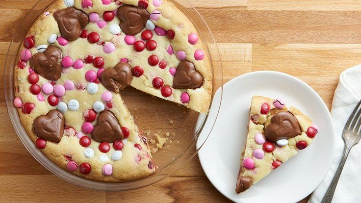 This adorable cookie pie is loaded with chocolate and peanut butter candy and is sure to win over your Valentine!