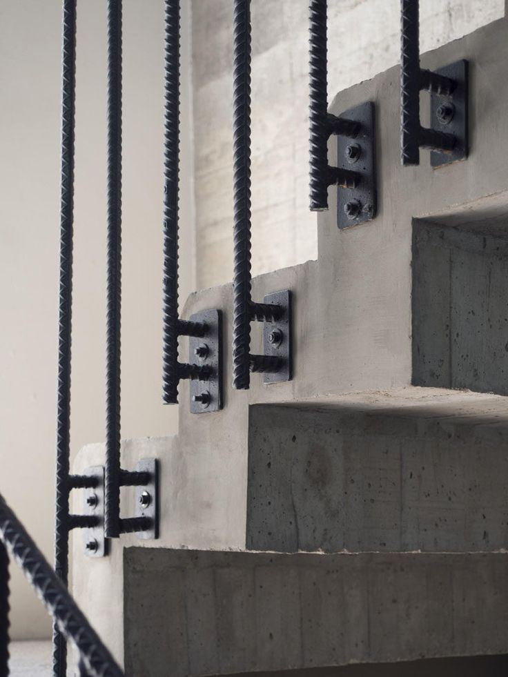 Interior Design Details - Industrial Close Ups // The steel rebar supports for the railing and the concrete of the actual steps give this staircase a modern, industrial look.