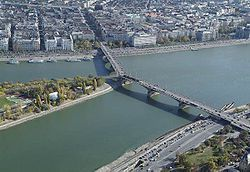 1876-Margit híd or Margaret Bridge (sometimes Margit Bridge) is a bridge in Budapest, Hungary, connecting Buda and Pest across the Danube. It is the second northernmost and second oldest public bridge in Budapest.