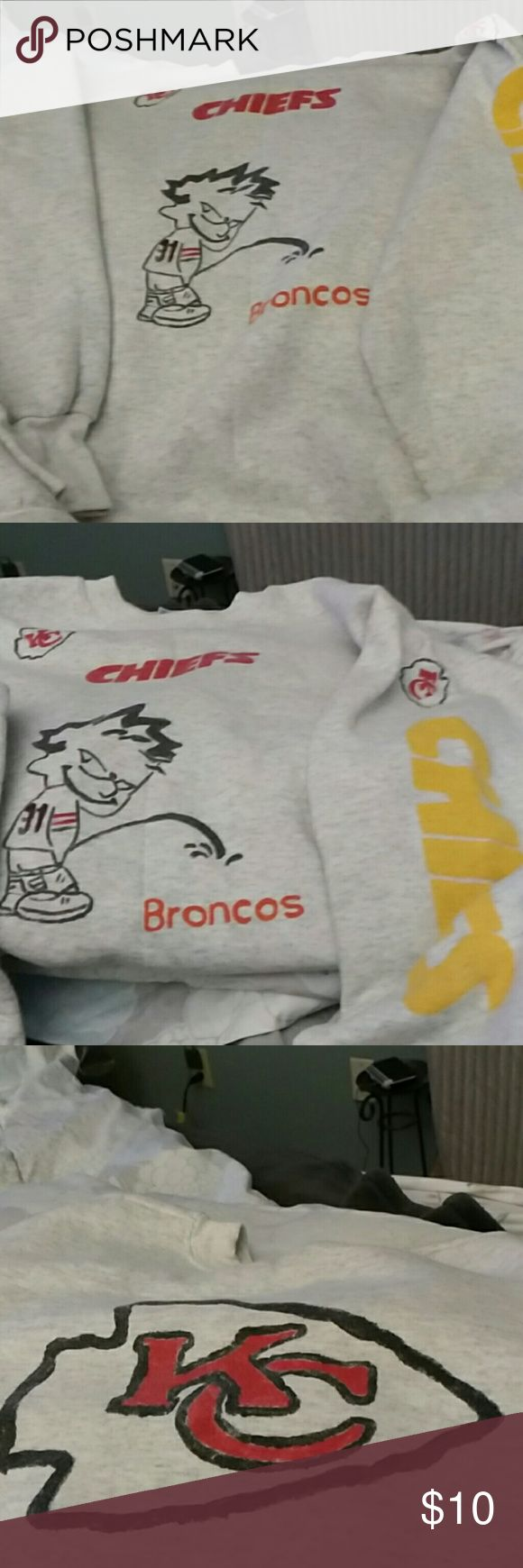 Adult handmade Chiefs sweatshirt Chiefs logo with person peeing on Broncos. Chiefs down sleeve. Arrowhead on back. Very cute. Made by my ex Mother-in-law. Tops Sweatshirts & Hoodies
