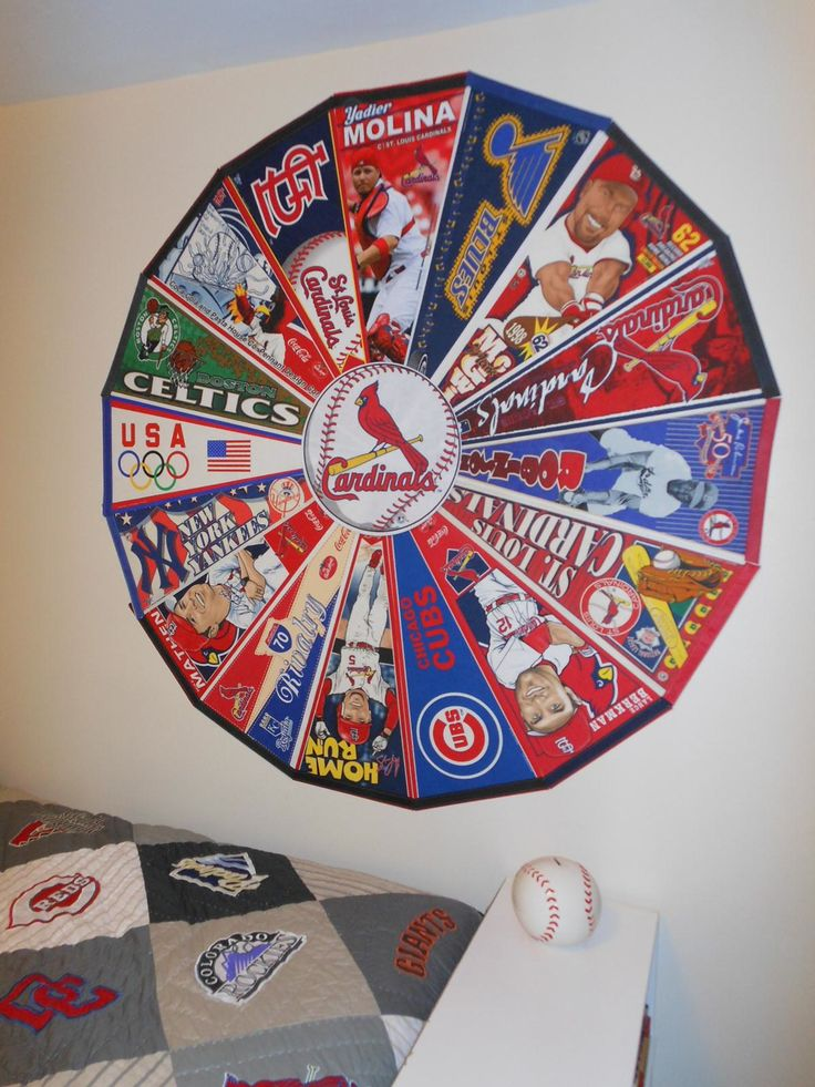 For my son's baseball-themed room, this is how we arranged his vast pennant collection using 3M mounting tabs, a lot of them.