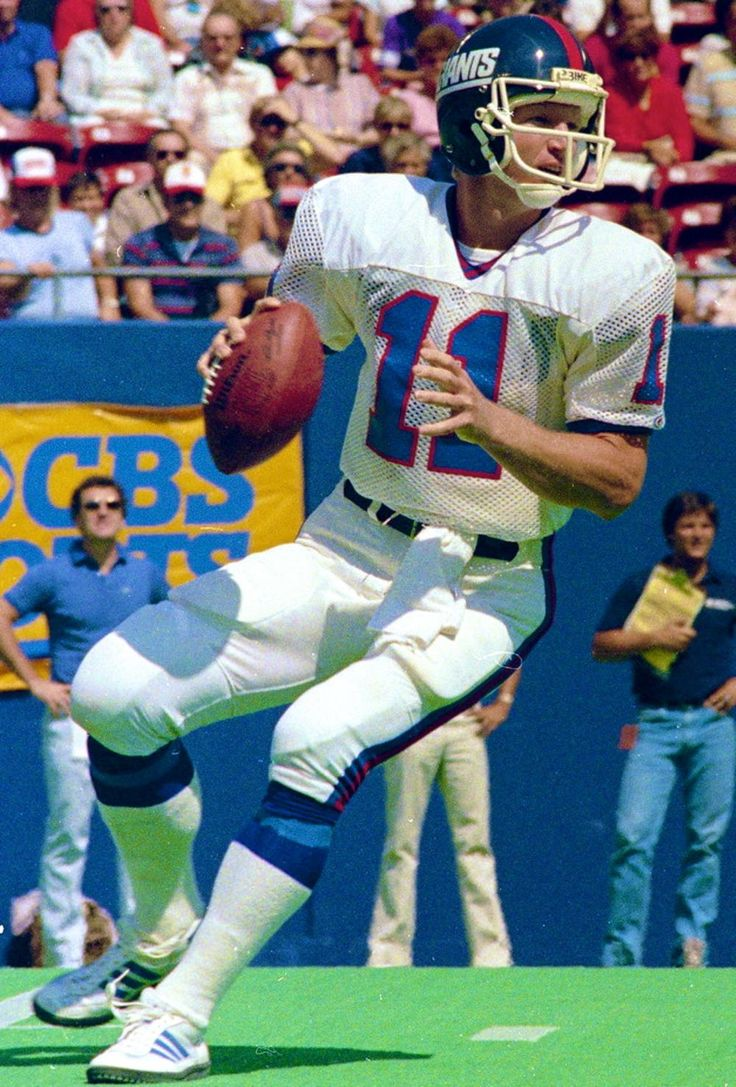 Phil Simms is considered one of the top quarterbacks of all time. As an All-Pro Quarterback, Simms led the New York Giants to two Super Bowl titles (XXI and XXV). In Super Bowl XXI, he completed 22 of 25 passes, for 268 yards, defeating the Denver Broncos, 39-20. He set Super Bowl records with consecutive completions (10), accuracy (88%) and passer rating (150.9). Simms was rewarded with the Super Bowl MVP award and gave the Giants franchise their first Super Bowl title.