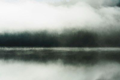 Abstract photograph of foggy morning where the lake meets the forest. Taken at Åresjön in Jämtland, photographer Jonas Anhede. It almost looks like a painting by Monet. Available as poster at printler.com, the marketplace for photo art.