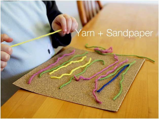 Yarn and sandpaper - perfect for practicing letter and number formation.