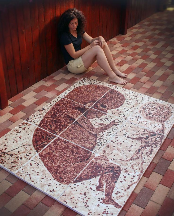Artist Timi Pall with her work of art | This woman used period blood of nine months to paint an unborn child
