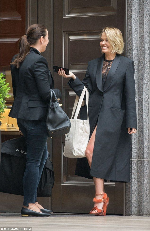 What under the coat? On Wednesday Lara Worthington (nee Bingle) was spotted shopping at lu...