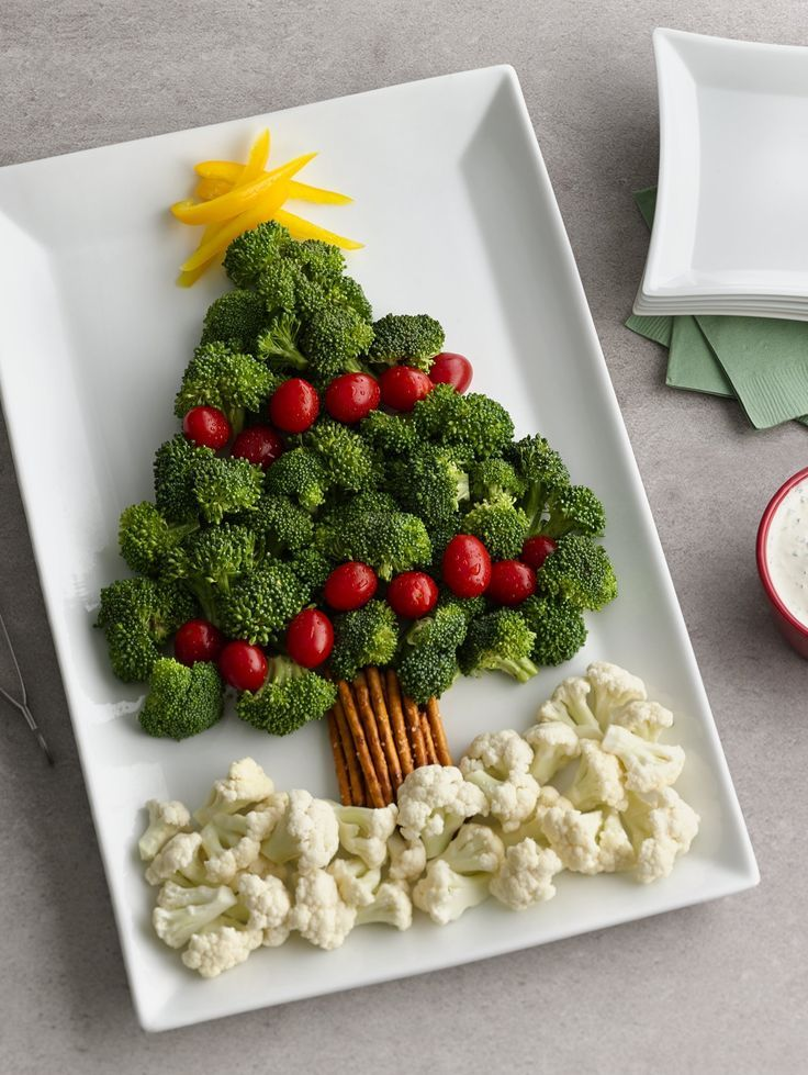 "A broccoli and tomato ""tree"" with a pretzel ""trunk"" and cauliflower ""snow"" makes for a memorable and easy Christmas appetizer!:"