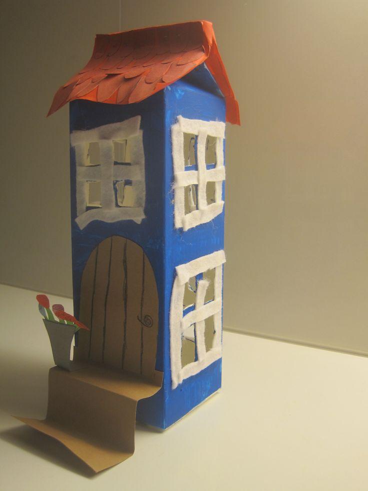 8-vuotiaan tyttären maitopurkista tekemä Muumi-talo