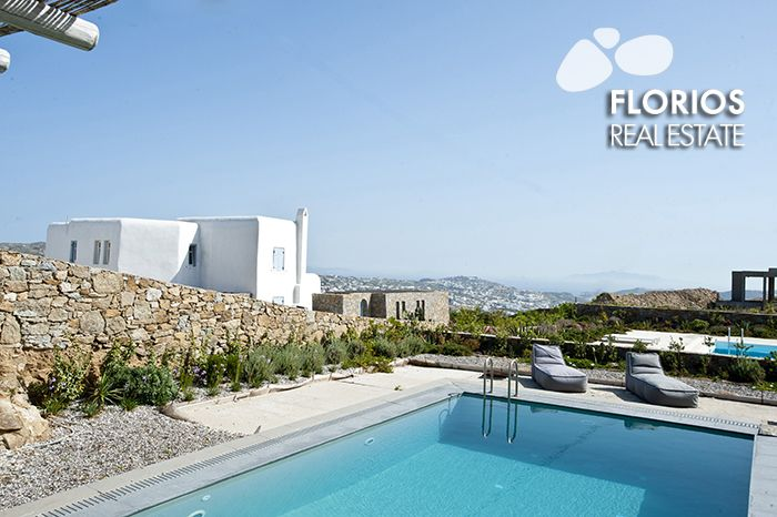 The swimming pool is directly accessible from the upper floor as well as the lower floor by an external stairway. The swimming pool area has a distant view over the port in the town of Mykonos and the characteristic rocky hills of the island. Villa for Sale on Mykonos island, Greece. FL1486 http://www.florios.gr/en/mykonos-property/9.html