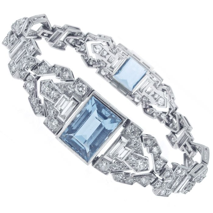 Platinum diamond and aquamarine Art Deco bracelet. This 1930s bracelet features two rectangular step-cut aquamarines weighing 9.00 carats and one hundred thirty-one diamonds that have a total weight of 7.60 carats. French Circa 1925