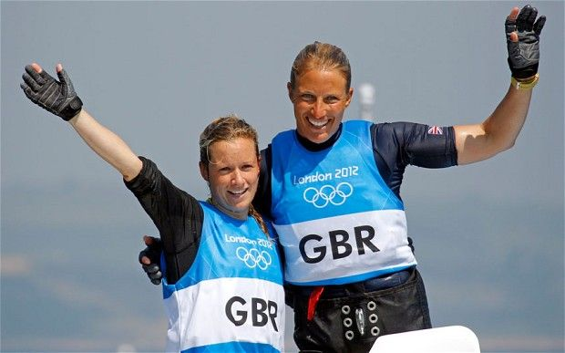 Britain's Hannah Mills and Saskia Clark celebrate as they cross the finish line to win silver in the women's 470