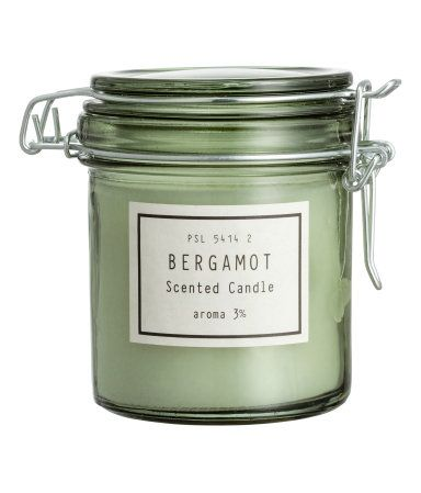 Dusky green/bergamot. Scented candle in a glass jar with a decorative label and lid with metal bail closure. Diameter 3 in., height 4 in. Burn time 30 hours