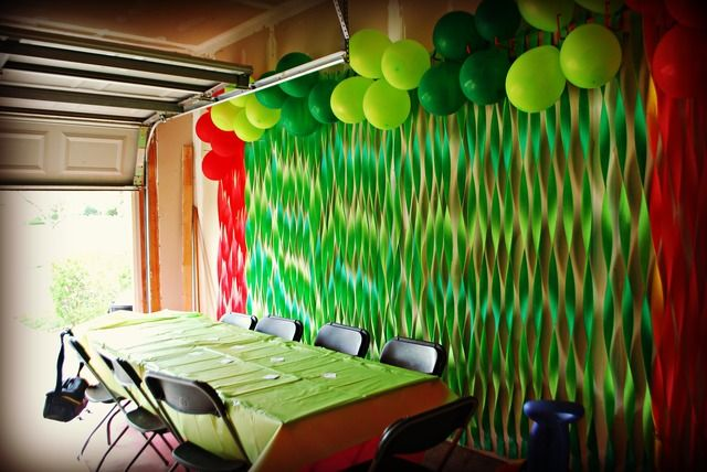 Red and green balloons and streamers. Very hungry caterpillar birthday party