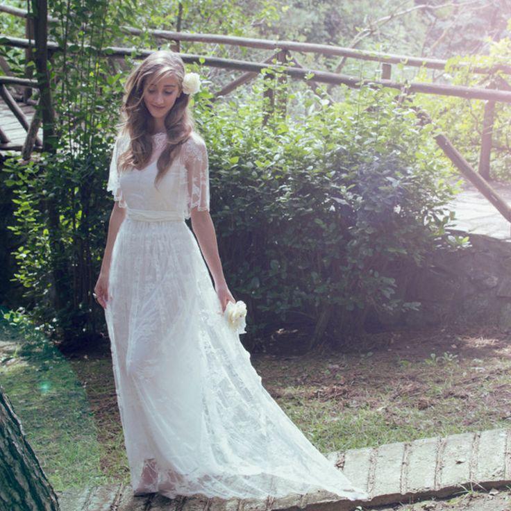 Znalezione obrazy dla zapytania suknia ślubna w stylu boho