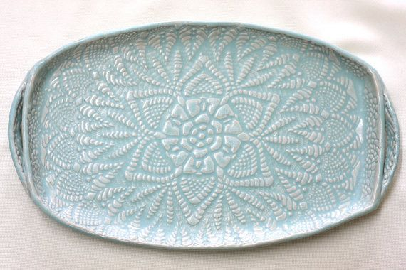 Handmade pottery -- texture courtesy of a lace crochet doily -- from Fringe & Fettle. As seen in Country Living Oct 2013
