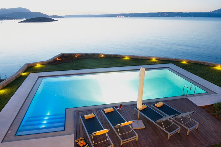 SK Place - Almyra Residence Crete Sleeps up to 6. With blissful bay views from the exceptional swimming pool terrace, and from almost every room in the house, this luxury villa in Crete is set above the water, a very short stroll from the beach.