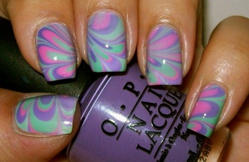 Swirl multi - Colored nail design featuring pink green and blue