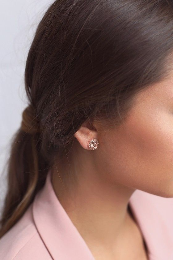 """Fulfill your destiny to be forever fashionable with the Realized Potential Rose Gold Rhinestone Earrings! Shiny rose gold setting houses a round rhinestone focal, surrounded by a ring of smaller rhinestones. Earrings measure just under 0.5"""" tall."""