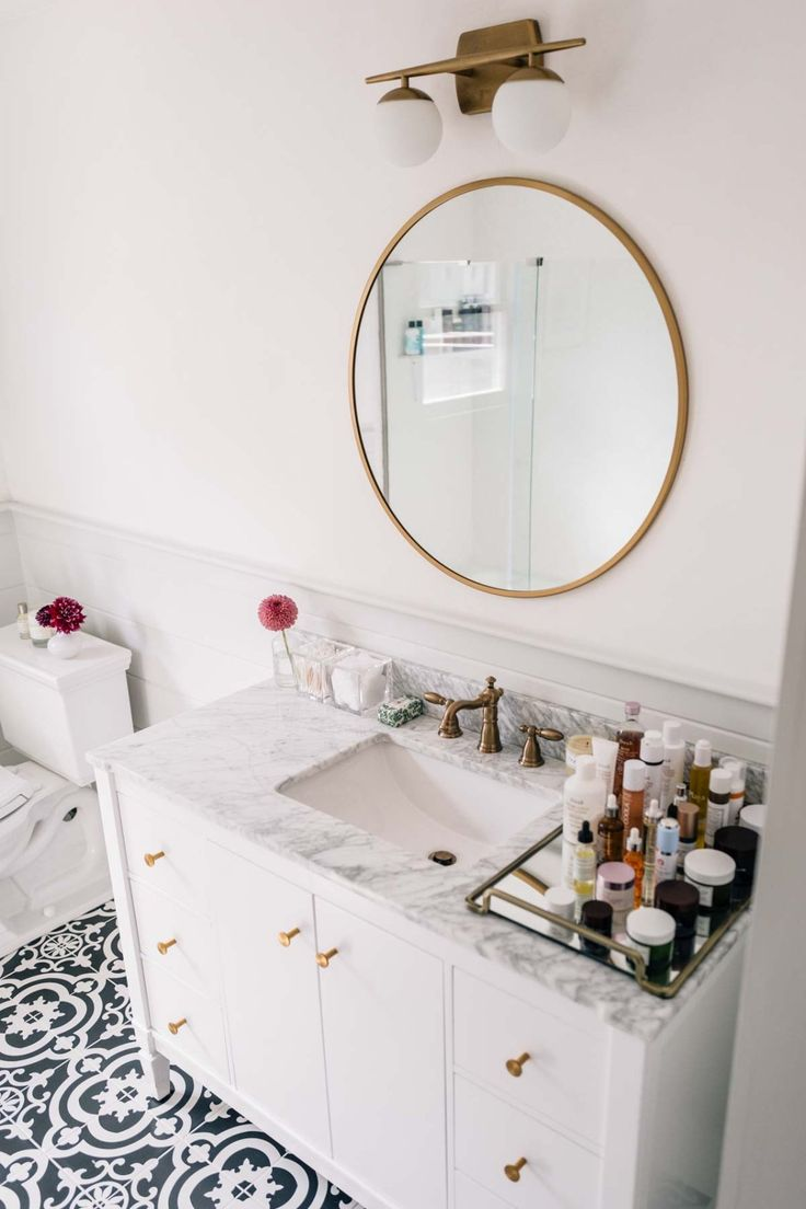 It's all in the details. Jess Ann Kirby's bathroom renovation is big on style, boasting bold tile and modern hardware finishes. Click this pin to see the complete transformation.