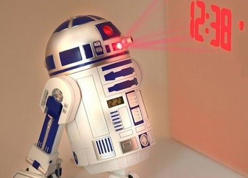 Star Wars R2-D2 LED Alarm Clock $49.99 The R2-D2 Projection Alarm Clock is storm-trooping its way into bedrooms across the galaxy. Just set the alarm and R2 will burp, bleep, tweet and twitter you awake and he'll even project the time, date and seconds onto your ceiling when the alarm goes off, your wall or the Wookie sleeping beside you (just adjust the angle with his legs). #r2d2 #starwars #alarm #clock #projection