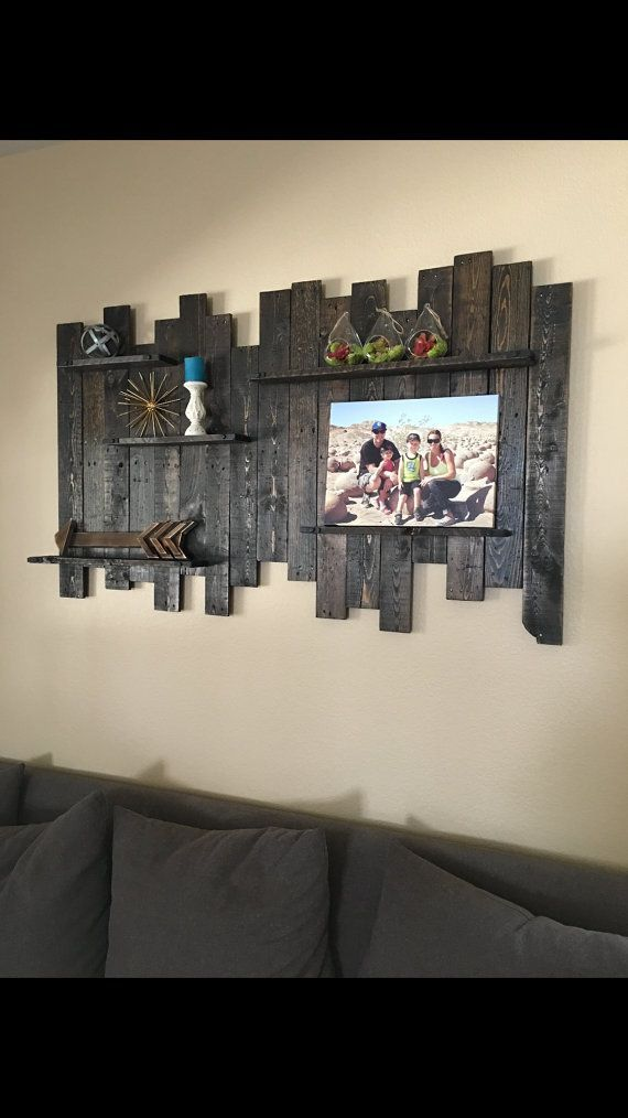 Rustic Reclaimed Wood Wall Decor/Shelving 60 Wide x 36 High x 3.5 Deep (inches) Item shown in Dark Walnut Stain Sealed with polyurethane, light sheen Solid steel accents with hex head bolts, satin black finish Piece contains all original wear, nail holes, marking, cracks, imperfections. Includes keyhole hangers on backside for hanging. Weight will vary: 25-50#  Your piece will contain similar but not identical markings and wear. Each piece is handmade and made for YOU. This item is sanded…