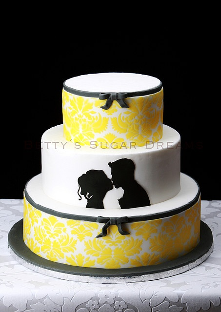 Black, white and yellow damask silhouette wedding cake like the idea of the silhouette on just a white cake with a yellow flower laying close by