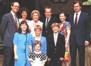 President Richard Nixon and Pat Nixon with their family - standing back left to right: David Eisenhower, Julie Nixon Eisenhower, Pat Nixon, Richard Nixon, Tricia Nixon Cox, Ed Cox. Standing front: Melanie Eisenhower, Alexander Eisenhower, Christopher Nixon Cox, and in front Jennie Eisenhower.