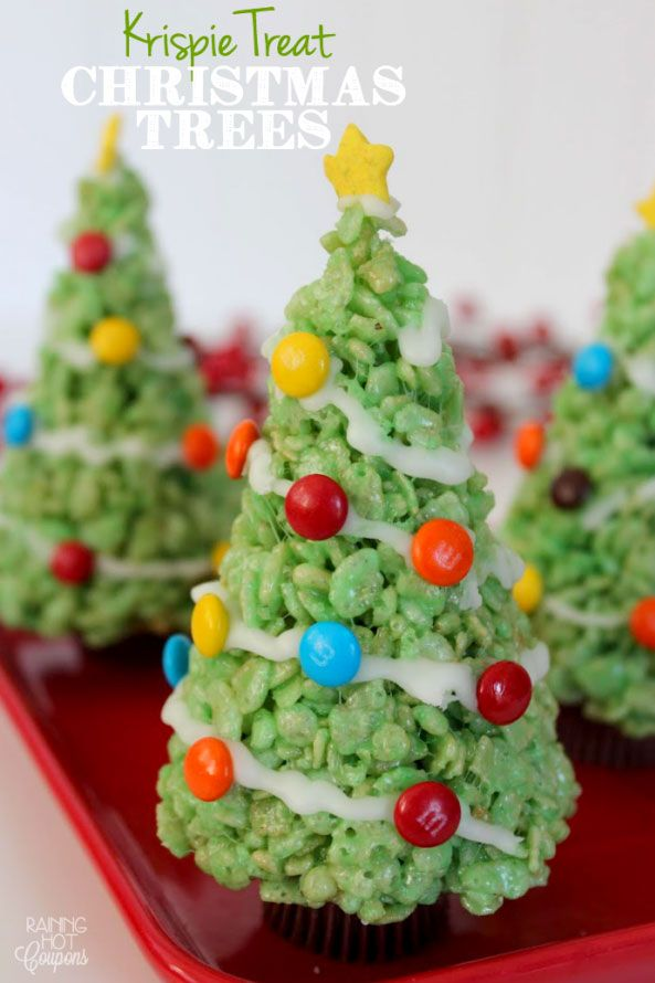 """This simple recipe allows your kids to help out in the kitchen. Just don't be surprised if they try to eat an M&M """"ornament"""" or two while you're baking these Krispie Treat Christmas Trees."""