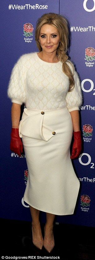 Carol Vorderman adds a patriotic touch to her white statement skirt