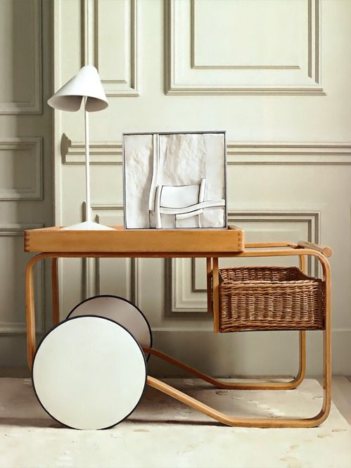 Alvar Aalto tea trolley model 900, designed in 1936-1937 and produced by Artek Oy. Materials: Birch, natural lacquered. ceramic tiles and a rattan basket. / BonLux