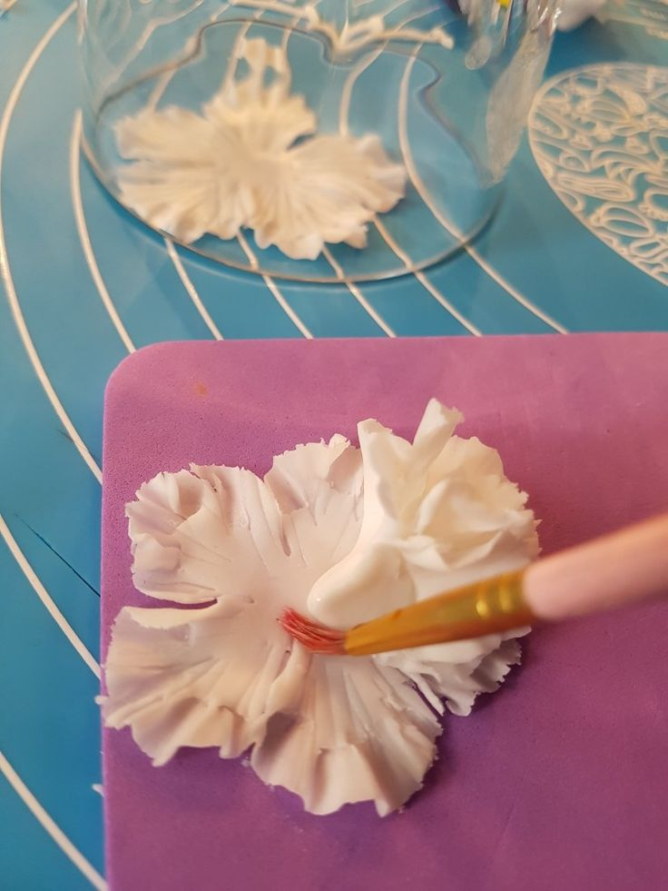5. Repeat using slightly larger cutter. Wet centre or use a dab of edible glue to stick previous petals in centre