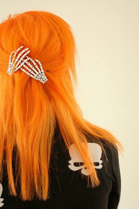 I love the bright orange hair and those skeleton hand hair clips