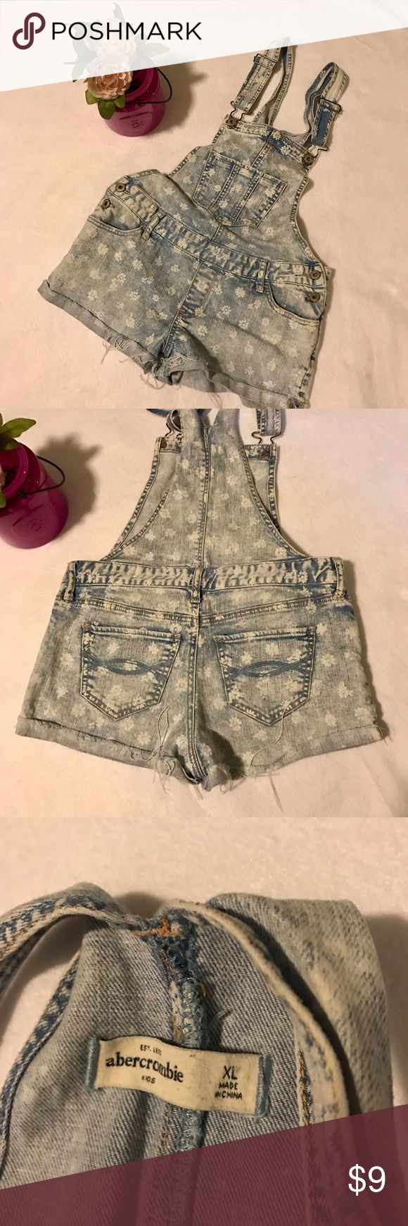 Abercrombie Kids girls overall Shorts XL Adorable distressed Abercrombie girls short overalls. Very cute- Size XL- I would think would fit 10-14? Flower print and distressed cuffed style. abercrombie kids Bottoms Overalls