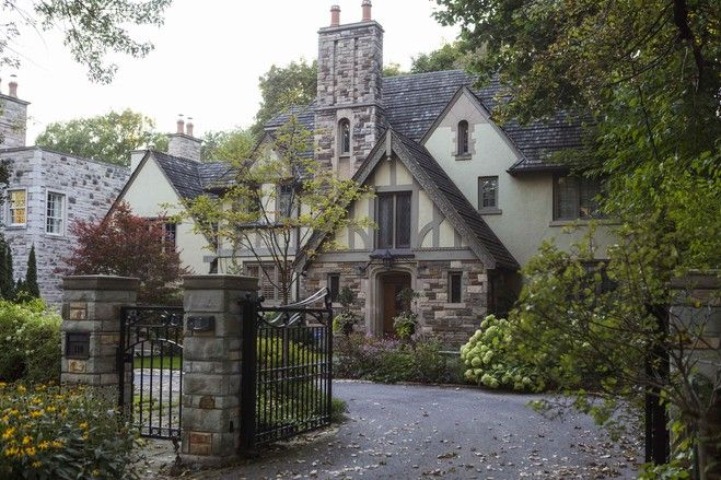 Classic Tudor-style homes are making a comeback. The reqs: pitched gabled roofs, large chimneys, latticed windows, black-and-white facades--and a general fairy-tale look. (Source: Philip Cheung for The Wall Street Journal)