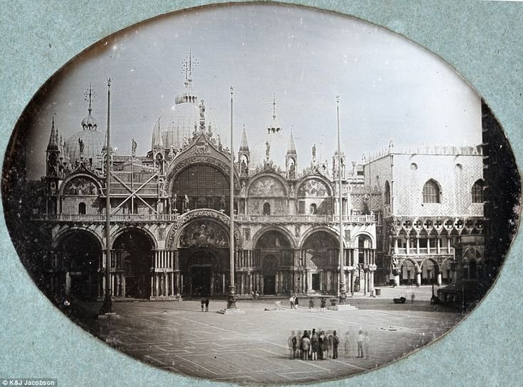 A small group of people gathers at the piazza in front of St. Mark's Basilica in Venice in 1845; today the square is teeming with tourists
