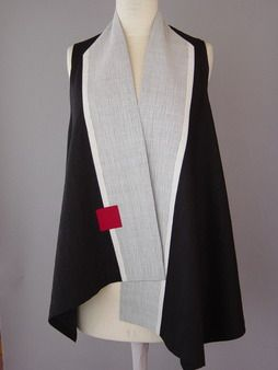 Wrapped Shoulder Vest in Black and White | Classic, elegant, dramatic. This vest is a linen/rayon that has been quilted to silk. The center front has a voile overlay that is stitched very closely and has a lace like feel to it.