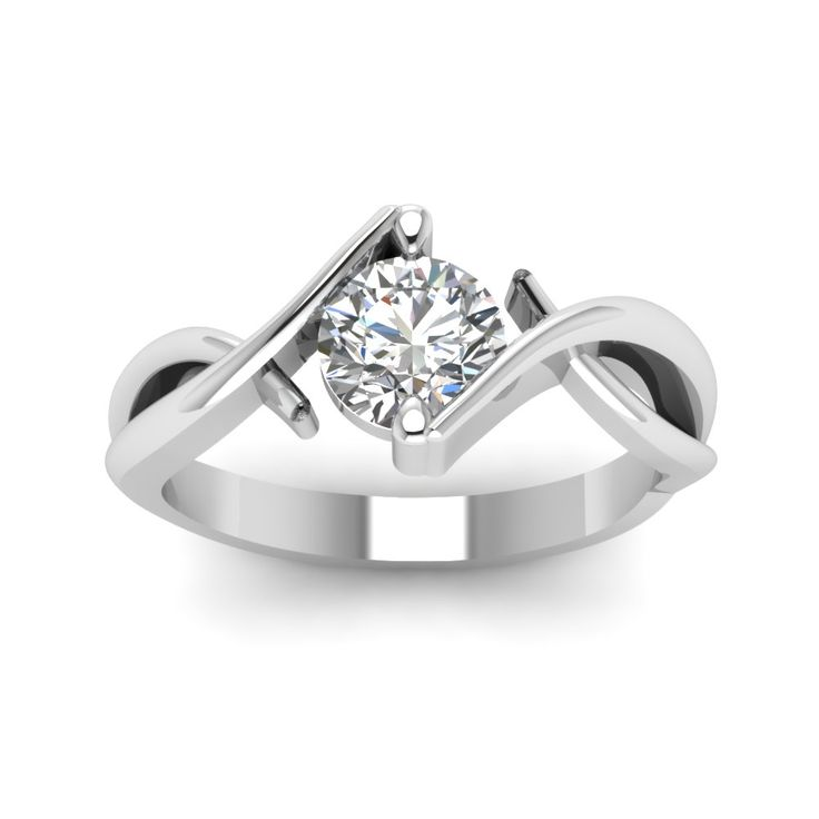 Beautiful Twist Single Round Cut diamond Solitaire Engagement Rings in 14K White Gold exclusively styled by Fascinating Diamonds