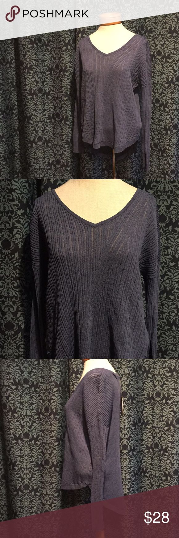 """NWT Jennifer Lopez High/Low Keyhole Top Classy up any outfit. Super cute keyhole accent in back. Long enough to cover your bum. Front has a crossover knit pattern that slims your torso. This is not necessarily a """"sweater"""", it's a lighter weight weave top and didn't know how to classify it. Jennifer Lopez Sweaters Crew & Scoop Necks"""