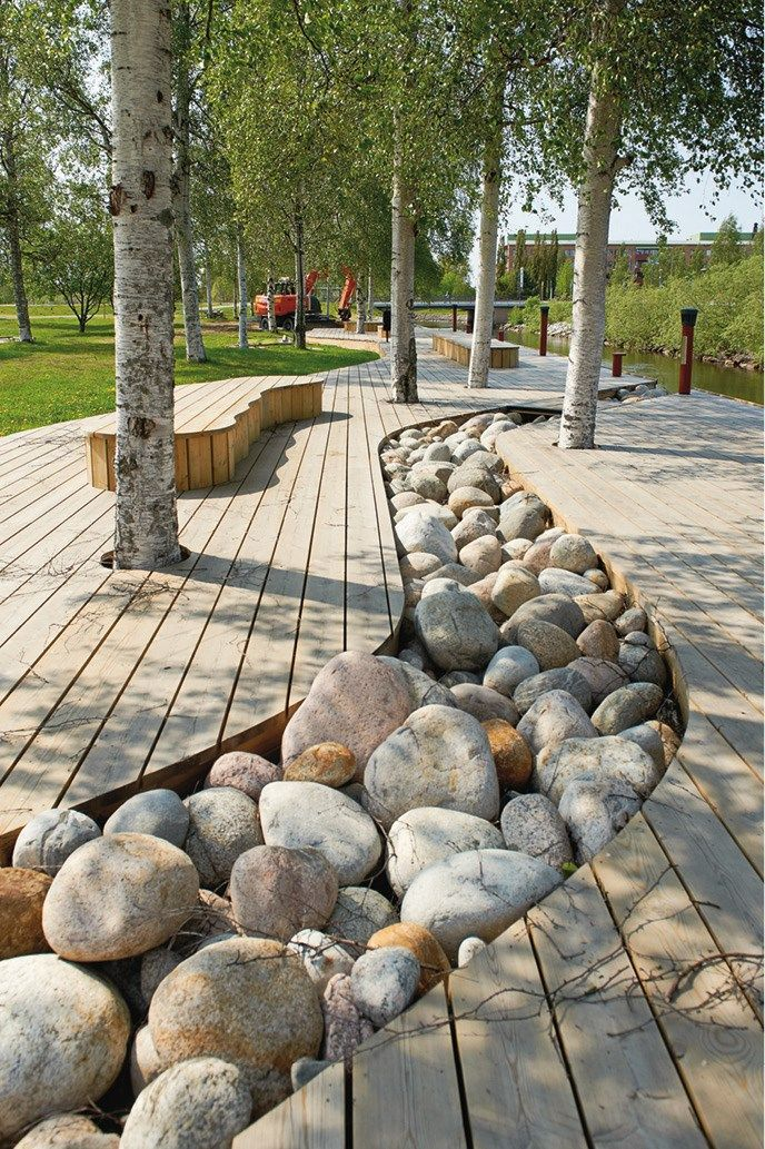 Riverbed pebbles... cut into decking to form a dry stream feature. Great look Skullybloodrider.
