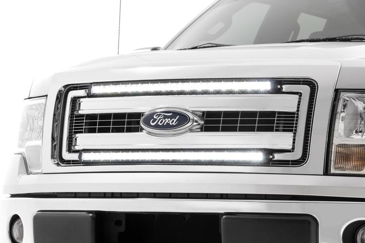 A fan-favorite add-on that looks like factory equipment, Rough Country's 30-inch Single-Row Light Bar Grille Mount Kit for the Ford F-150 includes everything you need to mount our 30-inch curved single row LED Light Bar in the factory opening of your truck's grille.