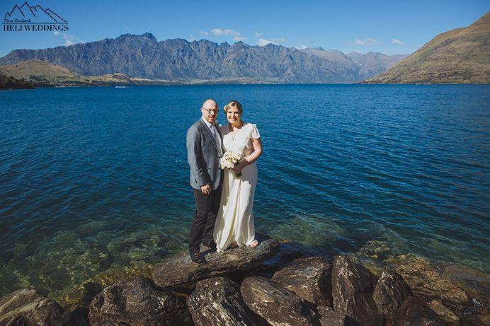Bride and Groom have wedding photos at Sunshine bay wedding, destination wedding ceremony, lakeside wedding Queenstown