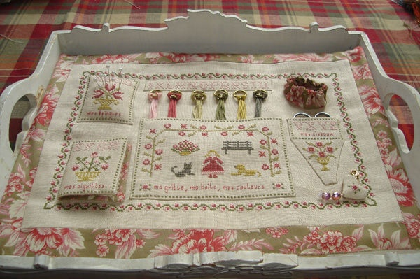 A needlework tray instead of a book, one that keeps all your threads and notions safe and to hand.
