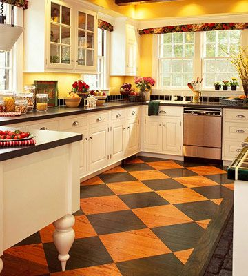 Dress Up Floors with Diamonds -- Jazz up an otherwise traditional kitchen by painting the floor in a diamond pattern. If the original wood is in good condition, let its natural color provide half of the color scheme. In this kitchen, the choice of black for the other half was guided by the color of the countertops and the dark hue of the ceiling beams.