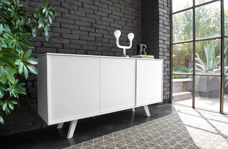 White ADAM cabinet for minimalist bedroom. Combine it with Calligaris POM POM table lamp in white.